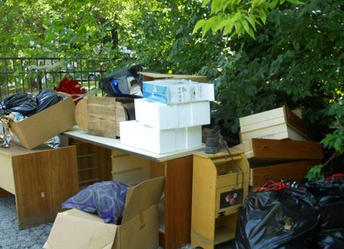 Pile of old dressers, drawers, and other bulk items